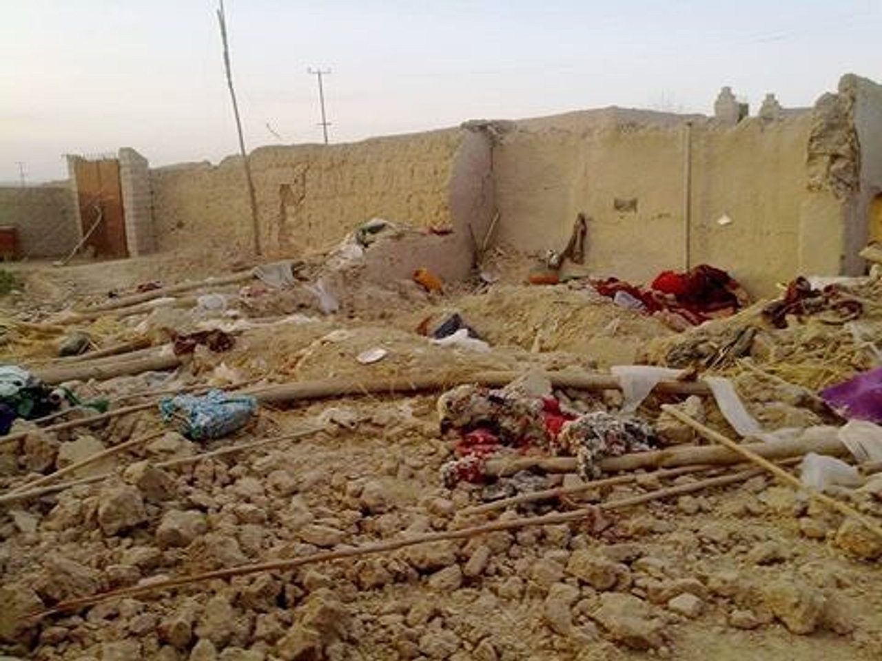 An image of one of the three air strikes, with damaged houses