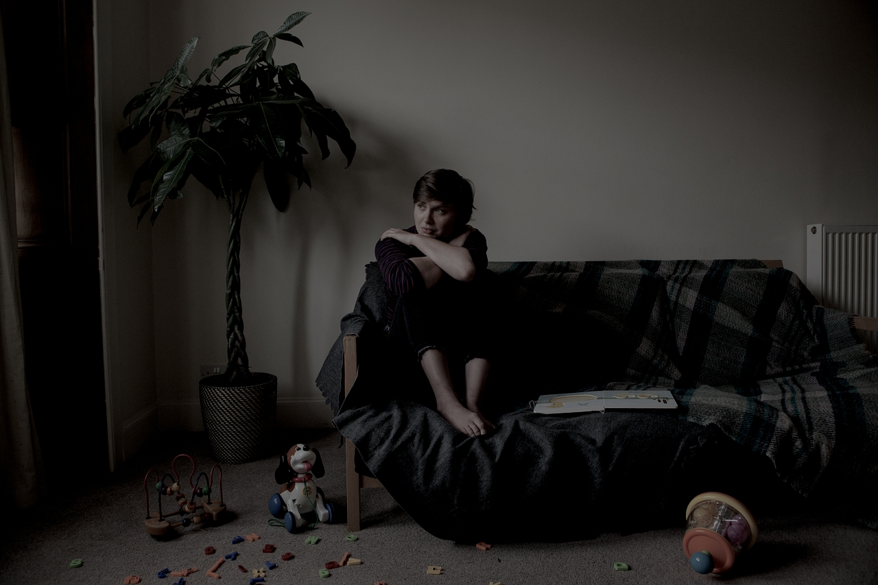 A stock image of a distressed woman in fear of domestic violence
